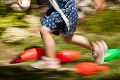 Little Feet on Garden Paths 27 (LongInt57) Tags: motion blur running playing fun person people girl child children toys outdoor yard garden blue green red legs shoes feet foot pink kelowna bc canada okanagan panning