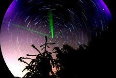 Playing with green laser in a summer night in the shadow of pine trees (dagherrotipista) Tags: startrails astrofotografia astrophotography nikond60 stars stelle laser