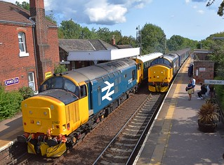 Double Large Logo 37s -  37407 propelling Directors Saloon 'Caroline' at Acle, waits for the 11.17 Yarmouth - Norwich service to clear the section, on an Ipswich - Peterborough, via Norwich and the Wherry Lines. 30 08 2018