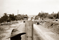 Early October 1941 - Australian Army, 19 Brigade, 2/1 Anti-Tank Regiment 2 pounder 'portee' ant-tank gun team northbound in convoy on the inland road to Haifa, Palestine (now Israel) (aussiejeff) Tags: haifa sepia boxbrownie ww2 australianarmy wwii 19brigade soldier war vintage historic military 2pdr 2pounder twopounder gun antitank portee truck jeffc aussiejeff israel australia palestine middleeast restore convoy
