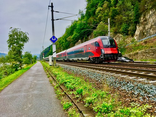 ÖBB railjet train passing river Inn between Kiefersfelden and Kufstein