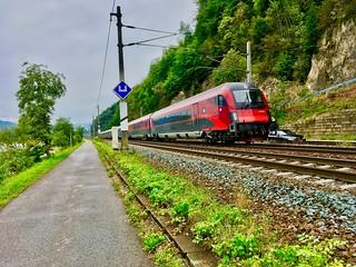 ÖBB railjet train passing river Inn between Kiefersfelden and Kufstein