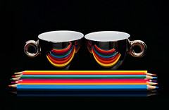 Pencil Reflections (njk1951) Tags: cups espressocups coffeecups mirrorfinishcups reflections pencils coloredpencils stilllife tabletopphotography colors brightcolors rainbowofcolors blackbackground