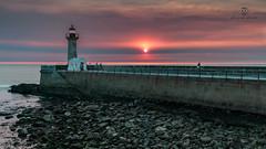 CIT0031 (pixFINEART) Tags: lighthouse sunset sun sky clouds lands landscape seascape seawall sea redsky rocks