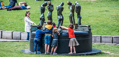 2018 - Belgium - Gent - Street People - 5 of 6 (Ted's photos - For Me & You) Tags: 2018 belgium cropped ghent nikon nikond750 nikonfx tedmcgrath tedsphotos vignetting park parkscene fountain waterfountain sculpture bronzesculpture people denim denimjeans kids children lawn grass nyc springofthebereaved springofthebereavedghent ghentspringofthebereaved ghentbelgium bronze