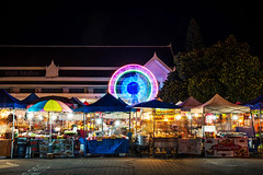Midnight Snacker's Paradise (Matt Molloy) Tags: mattmolloy timelapse photography timestack photostack movement motion ferriswheel colourful lights glow tents booths food vendors snacks drinks night market chaos blur wire interlockingbricks building chiangmaireligionpracticecenter chiang maithailandlove life
