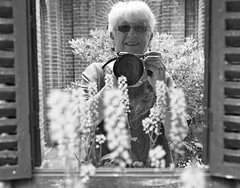 through the looking glass - explored (quietpurplehaze07) Tags: selfie alice lookingglass reflection shutters lewiscarroll bw mono explored