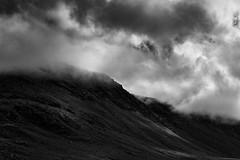 Light breaks through (rick miller foto) Tags: sigma 1750 80d canon monochrome mono blackandwhite overcast sunlight clouds mountain landscape hiking trails bonnebell tablelands canada unescoheritagesite nationalpark grosmorne newfoundland