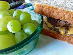 Grapes And A Cheeseburger. (dccradio) Tags: lumberton nc northcarolina robesoncounty indoor indoors inside cheeseburger doublecheeseburger sandwich bread meltedcheese burger meat food eat lunch dinner supper meal grape grapes bowl samsung galaxy smj727v j7v cellphone cellphonepicture