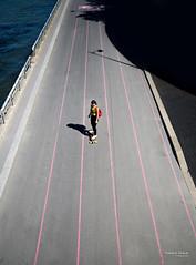 Street - Skate girl (François Escriva) Tags: skate skateboarder skateboarding girl woman colors red green pink sun light paris france olympus omd candid street streetphotography photo rue rolling