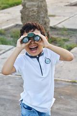 Telescope Kid 1 (iNezar) Tags: ifttt 500px exploring sunglasses active sun visor shielding eyes shorts discovering hiker trip squinting independent back pack child children kid telescope