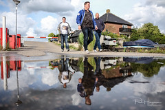 Reflections of men (PaulHoo) Tags: men people candid streetphotography puddle reflection water rain clouds waver vinkeveen jachthavenbon 2018