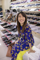 Young woman in Ao Dai shopping in shoe store (Apricot Cafe) Tags: img105743 aodai asia asianandindianethnicities hochiminhcity millennialgeneration tamronsp35mmf18divcusdmodelf012 vietnam vietnameseethnicity vietnameseculture bench carefree citylife colorimage cultures day fulllength happiness indoors lifestyles longhair lookingup oneperson oneyoungwomanonly people photography portrait realpeople serenepeople shoestore shopping sitting smiling straighthair talking toothysmile tourism tourist tradition traditionalclothing travel women youngadult hochiminh vn