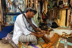 Al-Husn Leather Craftsman (Packing-Light) Tags: middleeast oman omani salalah khareef rain souk alhusn market shopping vendors rifle gun leather