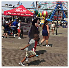 A Place for Fun & Family (Robert S. Photography) Tags: boardwalk costumedcharacter mickeymouse scene summer fun rides amusementpark wonderwheel coneyisland brooklyn nyc sony dscwx150 iso100 august 2018