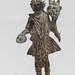 Roman bronze figurine of a Lar holding a patera and cornucopia