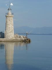 P1060286 (amalia_mar) Tags: φάροσ θάλασσα ουρανόσ βουνά ψαράσ ψάρεμα αντανακλάσεισ νερό άγιοσνικόλαοσαίγιο αίγιοαχαϊαελλάδα αιγιάλεια lighthouse sea sky mountains fisherman fishing reflections water aigioachaiagreece amaliamarinopoulou aigialeia sundaylights