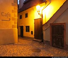 20170702_42 Café sign, lamp, & doors in Zlatá ulička a.k.a. Golden Lane at dusk   Prague, the Czech Republic (ratexla) Tags: ratexlasinterrailtrip2017 interrail 2jul2017 2017 canonpowershotsx50hs prague interrailing eurail eurailing tågluff tågluffa tågluffning travel travelling traveling journey epic europe earth tellus photophotospicturepicturesimageimagesfotofotonbildbilder wanderlust vacation holiday semester trip backpacking tågresatågresor resaresor europaeuropean sommar summer ontheroad city urban town praha prag českárepublika zlatáulička goldenlane history house houses building hus cute adorable sweet söt söta gullig gulligt gulliga evening night dusk dark darkness lamp streetlamp ratexla unlimitedphotos almostanything yellow sign signs favorite