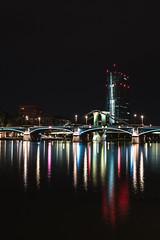 European Central Bank (ECB) (nicolas.mollier) Tags: ecb ezb europäische zentralbank reflections light colours main mainufer frankfurt nikon d7100 35mm f18 night cityscape bridge skyscraper river skyline
