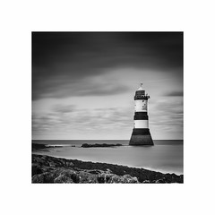 Penmon Lighthouse, Anglesey (Charles Connor) Tags: penmonlighthouse anglesey northwales lighthouses seascape monochromeseascapes monochrome contrast sea mono blackandwhite longexposure nd10stopfilter canondslr squareformat tranquility calmness clouds rocks