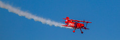 Laying A Smoke Trail (John Kocijanski) Tags: aerobatics lucasoilpittss111b plane airplane airshow newyorkairshow vehicle canon70300mmllens canon7d red