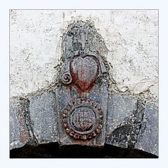 heart of stone (overthemoon) Tags: france savoie stmarcel 3vallées stmartindebelleville stone square frame church lintel worn symbols heart spiral cross chapellestmarcel