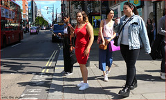 `2390 (roll the dice) Tags: london westminster w1 westend lights oxfordstreet people fashion bargain sale pretty sexy girls reaction mad happy smile sad fun funny streetphotographt canon tourism tourists shadows traffic portrait strangers candid urban unaware unknown england uk art classic sunny chilly weather crowd busy colour angry mobile phone headphones music taxi bus travel transport bald boots