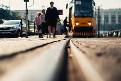 Suspended (ewitsoe) Tags: 35mm city europe ewitsoe nikond80 street warszawa erikwitsoe poland summer urban warsaw tram tracks line lowdof perspective track warsawcty poand polska people commuters summerday warm warmth citystreet