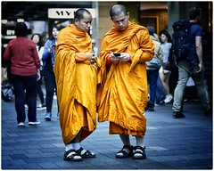 Modern monks (gro57074@bigpond.net.au) Tags: saffronrobe multiculturalism multicultural religion people pittstreetmall cbd sydney f40 105mmf14 artseries sigma nikon colour street candid candidstreetphotography orange monks buddhistmonks
