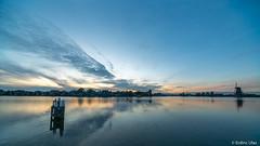 Landscape in Zaandam (✦ Erdinc Ulas Photography ✦) Tags: panasonic landscape view wide netherlands sigma816mm14556hsm water sunset sun blue mill windmill windmolen houses holland dutch zaandam city sigma colour gold wood coast reflection viltroxefm2