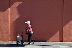 Rollin' On (Pedestrian Photographer) Tags: sunday dsc3786 woman laundry cart sidewalk wall shadows across street september 2018 photo walk chinatown los angeles california
