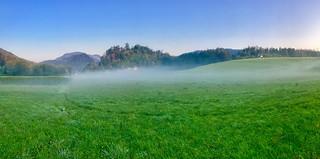 Morning mist over green fields near Hechtsee, Tyrol, Austria