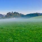 Morning mist over green fields near Hechtsee, Tyrol, Austria thumbnail