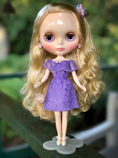 Tasha's all dressed up for a little landlubbing.  Off to her favourite salad bar and seafood buffet where she'll try not to eat the lobster shell like last time. Dress: Barbie Fashionista #93