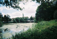 over the river leam (johnnytakespictures) Tags: disposable disposablecamera singleuse smile pocketsocket 35mm film analogue leamingtonspa leamington warwickshire river canal stream water leam nature natural landscape cloud clouds summer sun evening