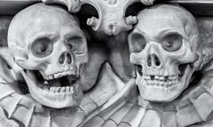 As I was saying............ (David Feuerhelm) Tags: monochrome bw blackandwhite noiretblanc schwarzundweiss negroyblanco contrast sculpture skulls pair two memorial kedington suffolk church nikon d750 2470mmf28