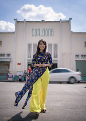 Young woman in Ao Dai walking in front of shopping mall (Apricot Cafe) Tags: img105712 aodai asia asianandindianethnicities benthanhmarket hochiminhcity millennialgeneration tamronsp35mmf18divcusdmodelf012 vietnam vietnameseethnicity vietnameseculture car carefree citylife colorimage copyspace cultures day fulllength hairtoss happiness lifestyles longhair oneperson oneyoungwomanonly outdoors people photography portrait realpeople serenepeople shopping shoppingmall sky smiling standing store straighthair toothysmile tourism tourist tradition traditionalclothing travel walking wall wind women youngadult hochiminh vn