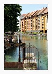 waterworks (overthemoon) Tags: france hautesavoie annecy colourful river water scenic frame gate wroughtiron architecture modern