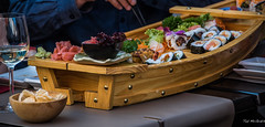 2018 - Belgium - Gent - Sushi Boat (Ted's photos - For Me & You) Tags: 2018 belgium cropped ghent nikon nikond750 nikonfx tedmcgrath tedsphotos vignetting wineglass food eating sushi californiaroll cafe restaurant wine drink glass wideangle widescreen bowl