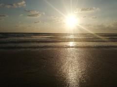 ... (essam_haffar) Tags: lebanon beirut outdoor sea ocean water waves sand horizontal horizon sun sunlight sunset clouds cloudyday reflection bluesky sky