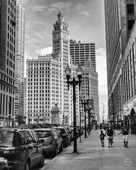A View up North Michigan Avenue (brianloganphoto) Tags: lamp street people day wrigleybuilding clouds urban bw monochrome skycraper landmark illinois cars historical buidlings chicago posts unitedstates us