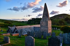 Brea Hill and St. Enodoc's Church (rustyruth1959) Tags: trees religiousbuilding goldcourse bronzeage tumuli tombs graves headstones grass broachtower tower sunset goldenhour camelestuary path bronzeageburials sanddunes southwestcoastpath daymerbay hill church stenodoc'schurch breahill rock trebetherick cornwall england kernow uk nikon1855mm nikond5600 nikon alamy