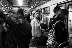 In white under the light (_storysofar_) Tags: streetphotography streetportrait portrait people crowd woman girl train light candid subway underground blackandwhite monochrome moscow russia fujifilm