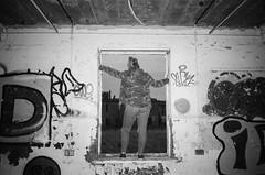 (esmeelily) Tags: 35mm film analog lomo lomography grain ilford black white is dead urbex derelict abandoned building raf upwood graffiti spraypaint street art vandalism tag tagging olympus trip af 50