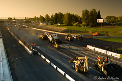 Echelon paving on the main straight (AndrewHaliburton.com) Tags: asphalt auto autodrome bitumen bridgestone car champ champcar championship circuit civil civilengineering construction contractor course echelon engineering grand grandprix indycar international motor motorracing motorsportspark oval overlay pir pavement paving portland portlandinternationalraceway prix race racetrack raceway racing reconstruction rehabilitation repave series smooth smoothness speedway tar track transfer transfervehicle vehicle oregon usa