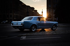 Riding with the blue pony into the sunset (iamunclefester) Tags: münchen munich sunset shade blue ford mustang pony dusk car chrome reflexion street sign mustangsally