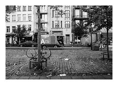 161015_b_00014_OM2n-ilford-delta-400_antwerpen_theaterplein 8/8 (A Is To B As B Is To C) Tags: aistobasbistoc b belgië belgium antwerpen antwerp olympus om2n analog film ilford delta 400asa bw blackwhite blackandwhite monochrome markt market a cleaning cleaners zaterdagmarkt bike trash tree city cityscape citylife urban street streetphotography house facade architecture