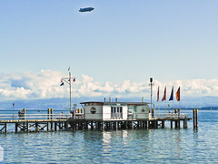 Hagnau am Bodensee - Germany (1120177) (Le Photiste) Tags: clay hagnauambodenseegermany bodenseegermany zeppelin zeppelindlzzf zeppelinntdlzzf water waterscape landscape mountains mountainlake clouds cloudy panasonic panasonicdmcfz4 boathouse boatdock ngc nature planetearthnature planetearth holidays happyholidays summerholidayseason vacances vacations ferien germany afeastformyeyes aphotographersview autofocus artisticimpressions alltypesoftransport blinkagain beautifulcapture bestpeople'schoice bloodsweatandgear gearheads creativeimpuls cazadoresdeimágenes digifotopro damncoolphotographers digitalcreations django'smaster friendsforever finegold fairplay greatphotographers peacetookovermyheart hairygitselite ineffable infinitexposure iqimagequality interesting inmyeyes lovelyflickr livingwithmultiplesclerosisms niceasitgets myfriendspictures mastersofcreativephotography photographers prophoto photographicworld planetearthtransport photomix soe simplysuperb showcaseimages simplythebest theredgroup thelooklevel1red vividstriking wow yourbestoftoday seascape