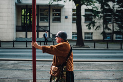 hold steady (ewitsoe) Tags: 35mm city europe ewitsoe nikond80 street warszawa erikwitsoe poland summer urban warsaw woman holdingon warm summerdays lastdays sepetmeber olderwoman lady tramstop glasses holding