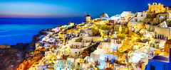 New Destinations Concepts. Sunset at Santorini Island in Greece. Image Taken in Oia Village At Dusk. Amazing Sunset with White Houses and Windmills in Frame. (DmitryMorgan) Tags: landscape aegean architecture aurora bluehour building caldera church cityscape destination dusk europe european famous greece greek hellenic historic holiday island iya landmark mediterranean mountain oia oya panoramic picturesque resort rock romantic santorini scenery sky slope summer summit sunlight sunny thera tourism town traditional traveling twilight view village volcano windmill